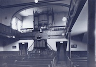 Interior, with the pipe organ prominent.