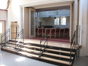 Through the portal you will find the steps down into the church hall. On the far side is a door to a lift for people who are less mobile. Alternatively, people can walk round the front of the building and in through the street entrance.